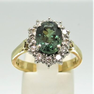 18 carat white and yellow gold green saphire and diamond