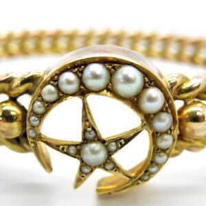 14 carat yellow gold with real pearls .