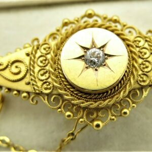 victorian 15 carat yellow gold brooch.